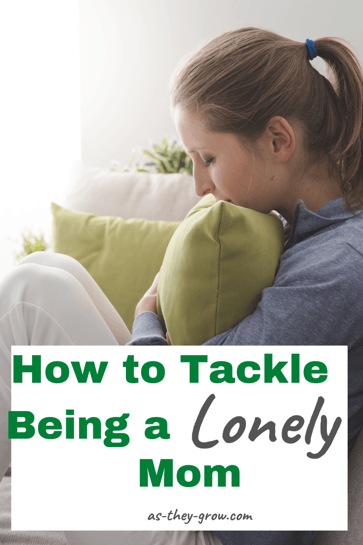 A lonely mom hugs a cushion, feeling alone and isolated. Caption reads, 'How to tackle being a lonely mom. As-they-grow.com.'