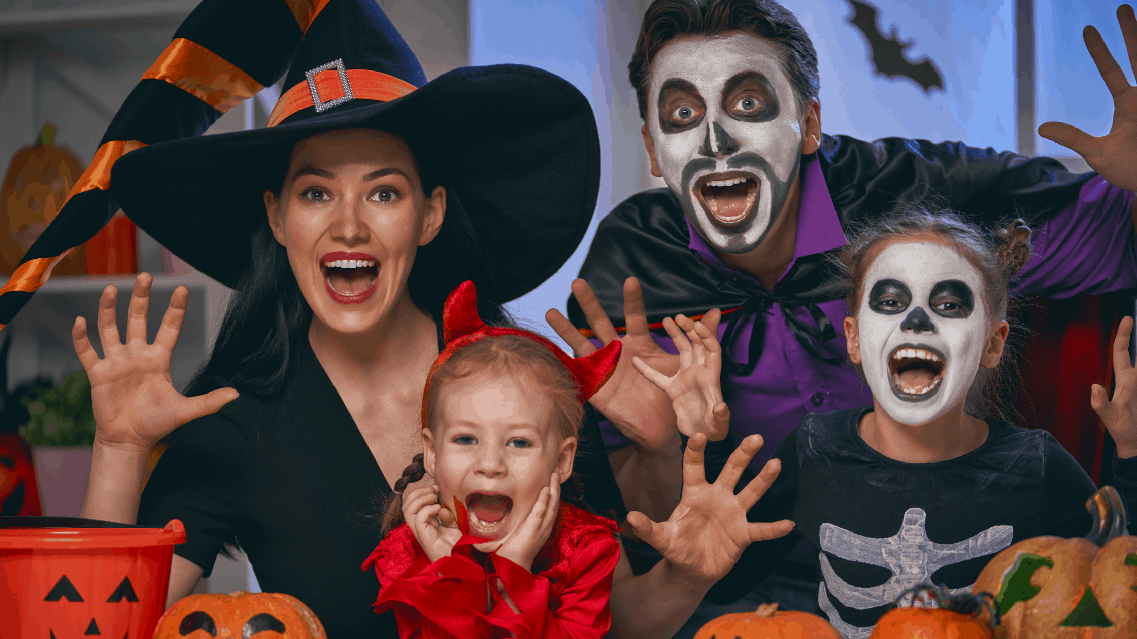 a family dressed for Halloween in Halloween costumes – a spooky Halloween 2020