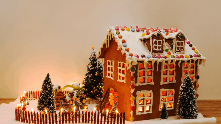 A gingerbread house decorated with sweets and icing.
