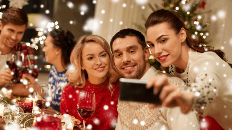 An online Christmas party where a people are talking to friends on a Facetime call in order to stay socially distanced this Christmas.