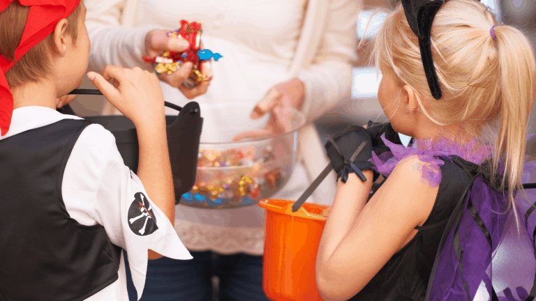 Children doing indoor trick-or-treating with members of their own family to stay safe this Halloween