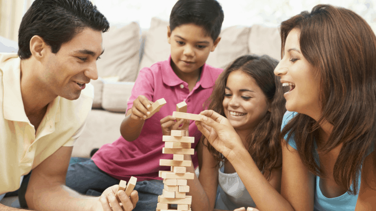 A family playing Jenga to stay connected in uncertain times