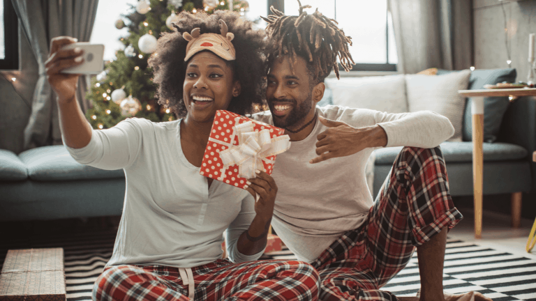 A couple opening their Christmas presents on a Zoom call on Christmas morning – a good way to stay connected to family but stay socially distanced.