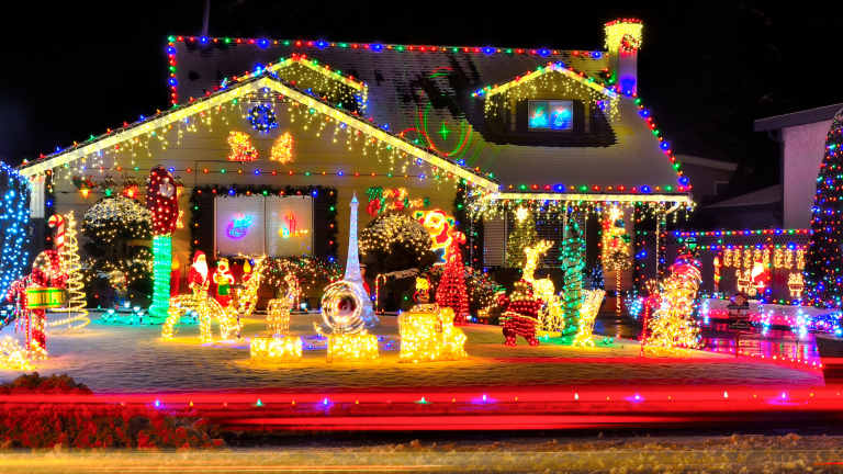 Family Christmas traditions: A house completely covered in Christmas lights and decorations.
