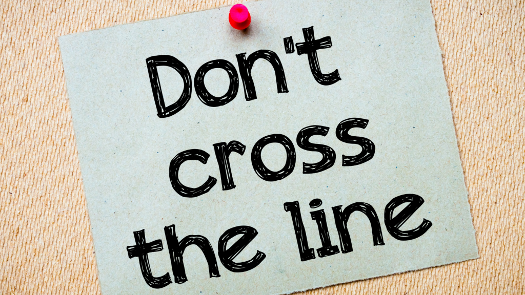 A piece of paper pinned to a board with the words, 'Don't cross the line' printed on it.