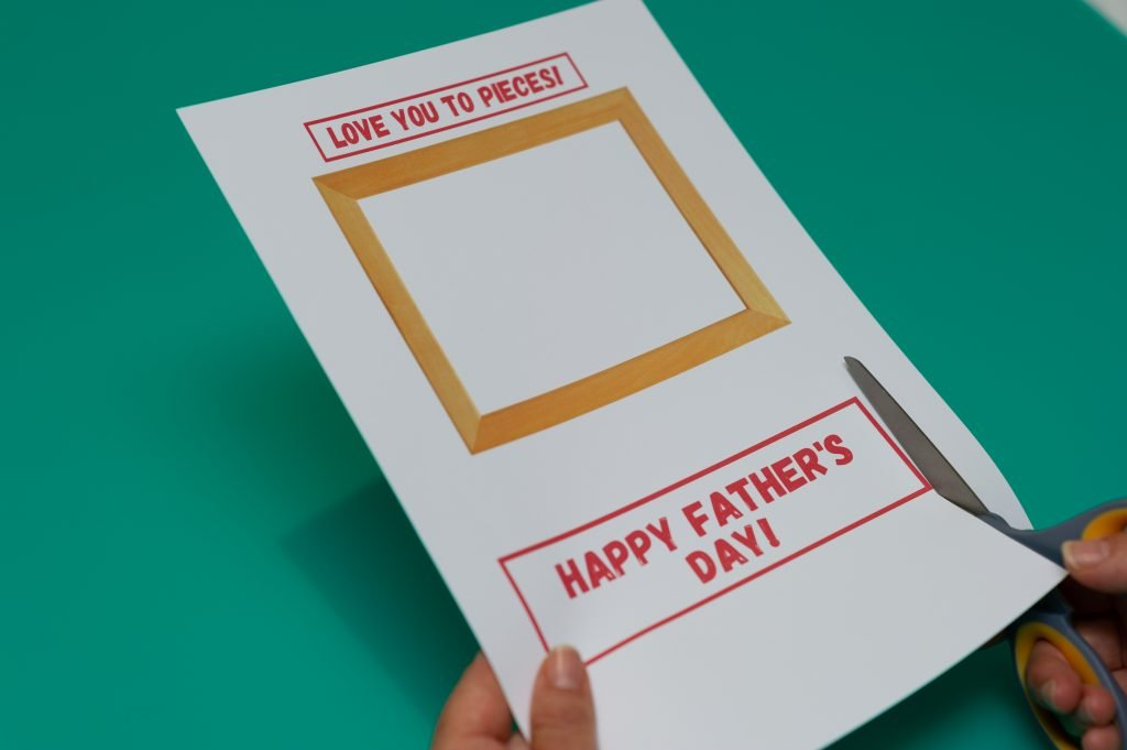 Cutting out frame and banners for Father's Day card