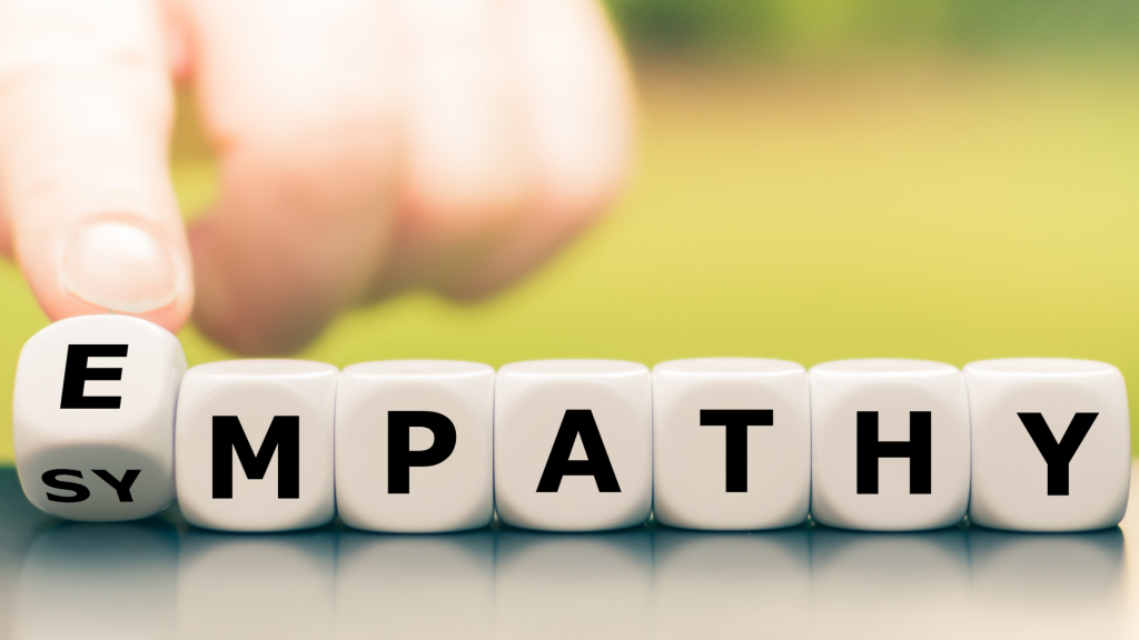 Letters on dice spelling the word empathy