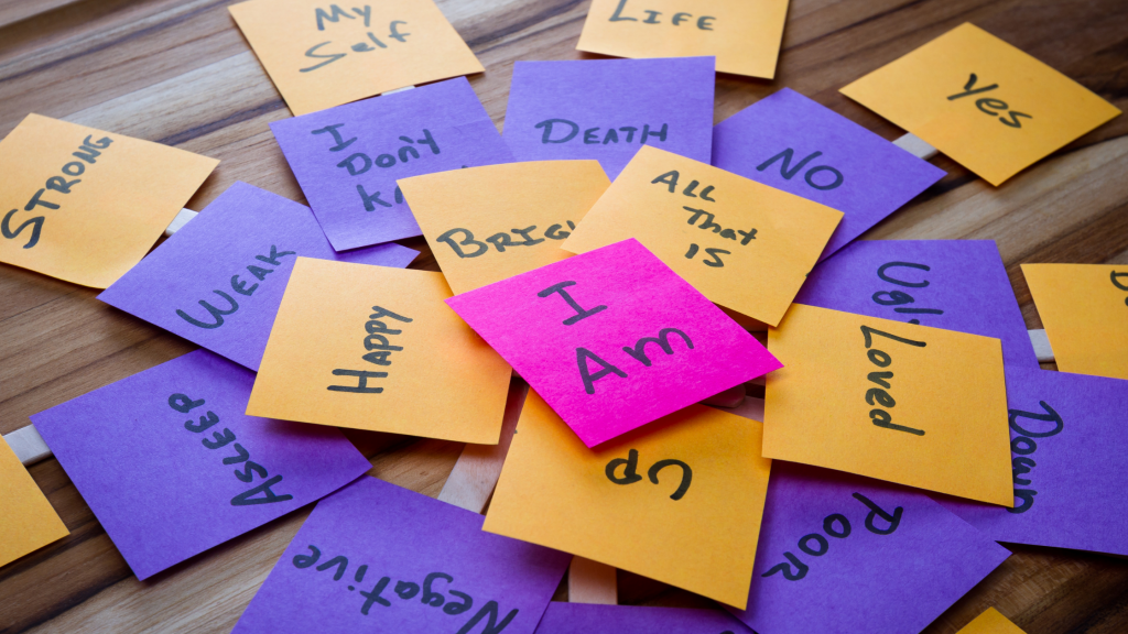 """Post it notes with """"I am' messages on to show self-esteem eg 'I am happy"""""""
